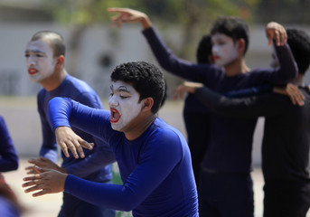 Performers take part in a mime to demonstrate for the rights of female farmers, at the University of Dhaka campus