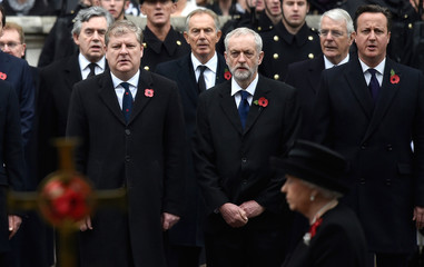 Britain's Prime Minister David Cameron, Jeremy Corbyn, the leader of the Labour Party, and Angus Robertson, the leader of the SNP's MP's in Westminster sing the national anthem at the Remembrance Sunday ceremony at the Cenotaph in central London