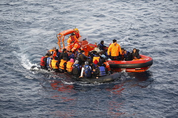 Turkish Coast Guard fast rigid-hulled inflatable boats tow refugees and migrants in a dinghy on the Turkish territorial waters of the North Eagean sea, following a failed attempt of crossing to the Greek island of Lesbos, off the shores of Canakkale