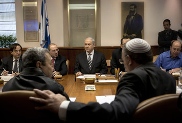 Israel's Defence Minister Ehud Barak sits across from Prime Minister Benjamin Netanyahu during the weekly cabinet meeting in Jerusalem
