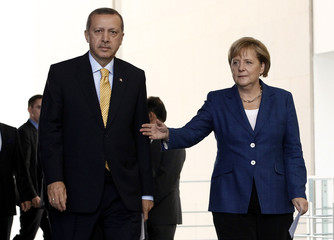 Turkey's PM Erdogan and German Chancellor Merkel arrive to address a news conference following their bilateral talks in Berlin