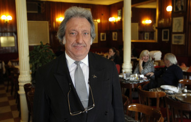 Waiter, public relations and writer Barcena poses inside Spain's historic Cafe Gijon in Madrid