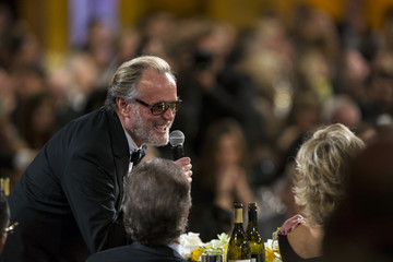 Actor Peter Fonda speaks to his sister Jane Fonda during the American Film Institute's 42nd Life Achievement Award at the Dolby theatre in Hollywood