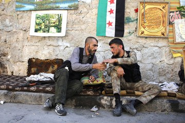 Free Syrian Army fighters rest in Aleppo's Bustan al-Basha district