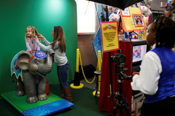 "Karin Albert fixes the hair of her daughter Lily Romanelli, 3, before posing her in an elephant themed photo booth at Ringling Bros and Barnum & Bailey Circus' ""Circus Extreme"" show at the Mohegan Sun Arena at Casey Plaza in Wilkes-Barre, Pennsylvania, U.S"