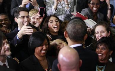 U.S. President Barack Obama greets workers after delivering remarks on energy at the Argonne National Lab near Chicago