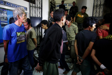 Police parade in front of media 15 MNLF Muslim rebels, who had surrendered to government soldiers, at police station in Zamboanga city