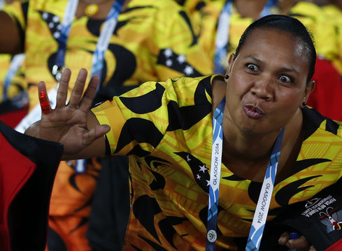 An athelete from Papua New Guinea arrives in the stadium for the opening ceremony for the 2014 Commonwealth Games at Celtic Park in Glasgow