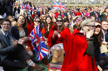 Royal fans applaud as they watch the wedding of Britain's Prince William and Catherine, Duchess of Cambridge on a large screen at St Andrews university in St Andrews