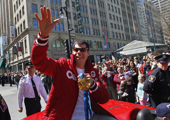Canadian snowboarder and Olympic gold medalist Jasey-Jay Anderson shows off his gold medal during a parade to honour Canada's Olympic athletes in Montreal