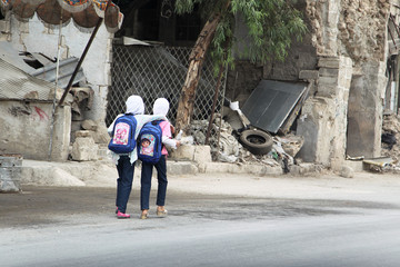 Girls walk to school in Old Aleppo