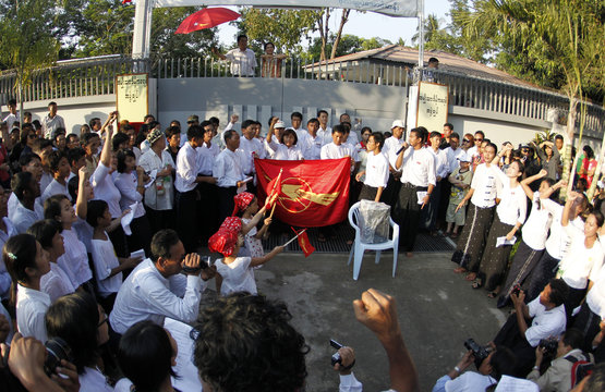 Activists from 88 generation students group, sing traditional chants as leader Suu Kyi listens in background as they celebrate Thingyan in Yangon