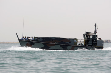 Yemeni coastguard officers ride a Dutch Navy boat during a joint training exercise in the southern Yemeni port of Aden