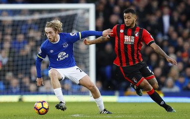 Everton's Tom Davies in action with Bournemouth's Joshua King
