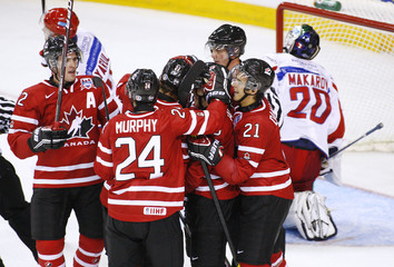 Team Canada celebrates their second goal in front in front of Team Russia Goalie Andrei Makarov  in Halifax, Nova Scotia