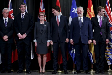 Canada's PM Trudeau poses with provincial and territorial premiers during the First Ministers' meeting in Ottawa