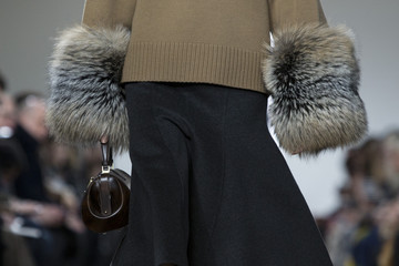 A model presents a creation from the Michael Kors Fall/Winter 2015 collection at New York Fashion Week