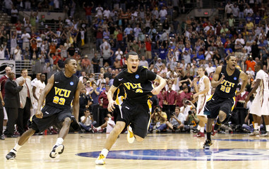 Rams' guards Burgess, Rodriguez and Brandenberg celebrate after defeating the Seminoles in overtime during their NCAA Southwest Regional college basketball game in San Antonio