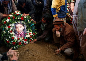 A picture of Nilofar, daughter of Afghan journalist Sardar Ahmad of Agence France-Presse, is placed on her grave in Kabul