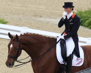 Cornelissen of the Netherlands riding Parzival reacts to her horse bleeding from the mouth during the World Dressage Championship at the World Equestrian Games in Lexington