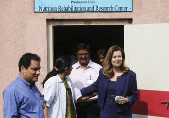 Trierweiler leaves a Nutrition Rehabilitation Centre in a slum in Mumbai