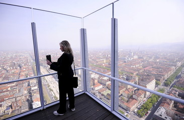 Woman takes a picture from new Intesa Sanpaolo skyscraper, designed by Italian architect Renzo Piano, in Turin