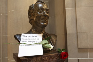 File photo of a thank you note and two roses are seen on a bust of former San Francisco Supervisor and gay rights pioneer Harvey Milk in San Francisco City Hall in San Francisco