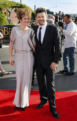 British actor Serkis and wife Ashbourne pose on the red carpet at the world premiere of 'The Hobbit - An Unexpected Journey' in Wellington
