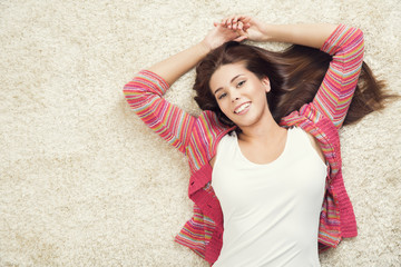 Woman Lying Down on Carpet, Happy Young Adult Girl Lie on Floor Top View
