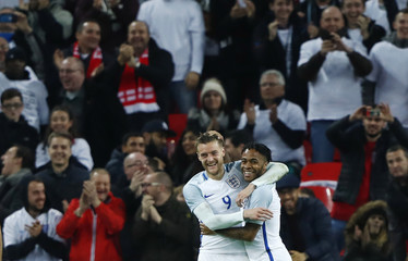 England's Jamie Vardy celebrates scoring their second goal with Raheem Sterling