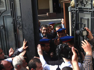 Presidential candidate from the Muslim Brotherhood and the FJP, Khairat al-Shater, leaves after presenting recommendation documents in Cairo