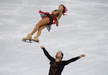 Russia's Vera Bazarova and Yuri Larionov compete during the Figure Skating Pairs Free Skating Program at the Sochi 2014 Winter Olympics