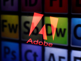 Picture illustration shows Adobe logo and Adobe products reflected on a monitor display and an iPad screen, in central Bosnian town of Zenica