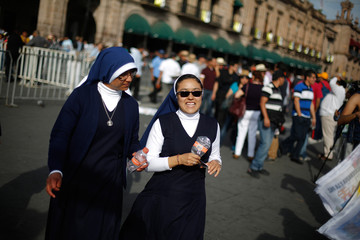 Nuns chat as they take a tour ahead of Pope Francis' visit in Morelia