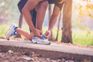 handsome man runners lace his shoes and prepare to jogging