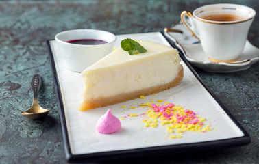 Piece of cheesecake on a rectangular flat plate