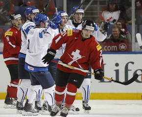 Players from Finland celebrate their goal against Switzerland in the second period of their game at the IIHF World Junior Championships in Buffalo