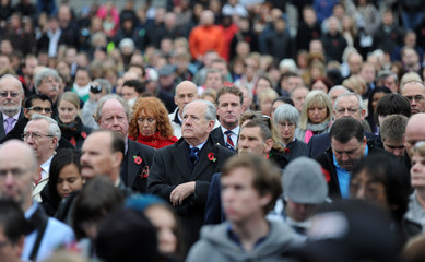 A crowd of people observe a two minutes silence to mark Armistice Day, in Trafalgar Square in central London