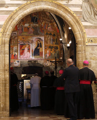 Pope Francis prays at the Porziuncola, the chapel inside the Saint Mary of Angels Basilica, in the Italian pilgrimage town of Assisi