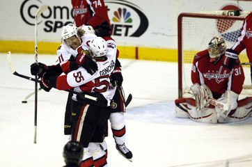 Ottawa Senators Daniel Alfredsson jumps into the arms of Sergei Gonchar after Gonchar scored the winning goal in overtime against the Washington Capitals during their NHL game in Washington