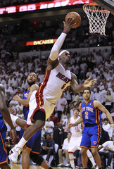 Miami Heat's James drives to the basket as New York Knicks' Fields looks on, during Game 1 of their first round NBA Eastern Conference playoff in Miami