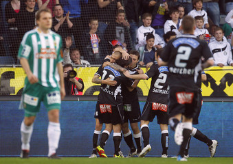 Players of Sturm Graz react after scoring a goal during their Austrian league soccer match against Rapid Vienna in Graz