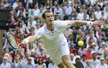 Andy Murray of Britain hits a return to David Ferrer of Spain during their men's quarter-final tennis match at the Wimbledon tennis championships in London