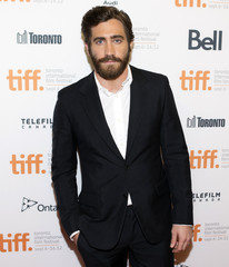 """Gyllenhaal arrives on the red carpet for the gala presentation of the film """"End of Watch"""" during the Toronto International Film Festival"""