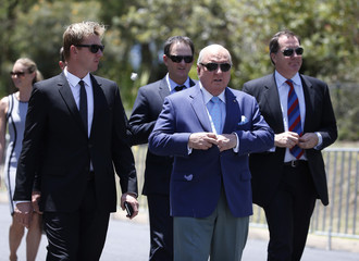 Former Australian cricketer Brett Lee and former Australian rugby union coach Alan Jones arrive at the funeral of Australian cricketer Phillip Hughes in his home town of Macksville