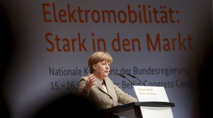 Merkel addresses a congress about the use of electric powered vehicles in Germany in Berlin