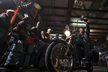 A biker leaves Suck Bang Blow biker bar in Murrells Inlet