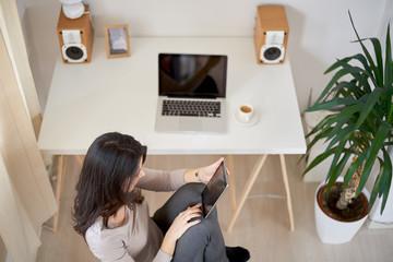 Caucasian girl in modern home office