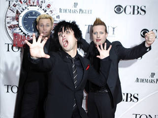 Musicians Mike Dirnt, Billy Joe Armstrong, and Tre Cool of the band Green Day arrive for the American Theatre Wing's 64th annual Tony Awards ceremony