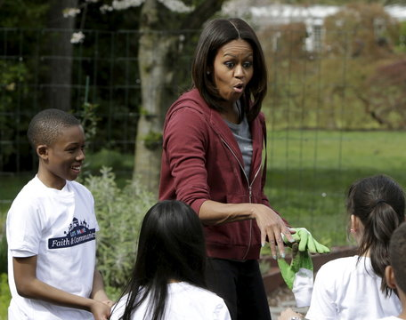 United States First lady Michelle Obama greets school children during spring planting of the White House vegetable garden in Washington
